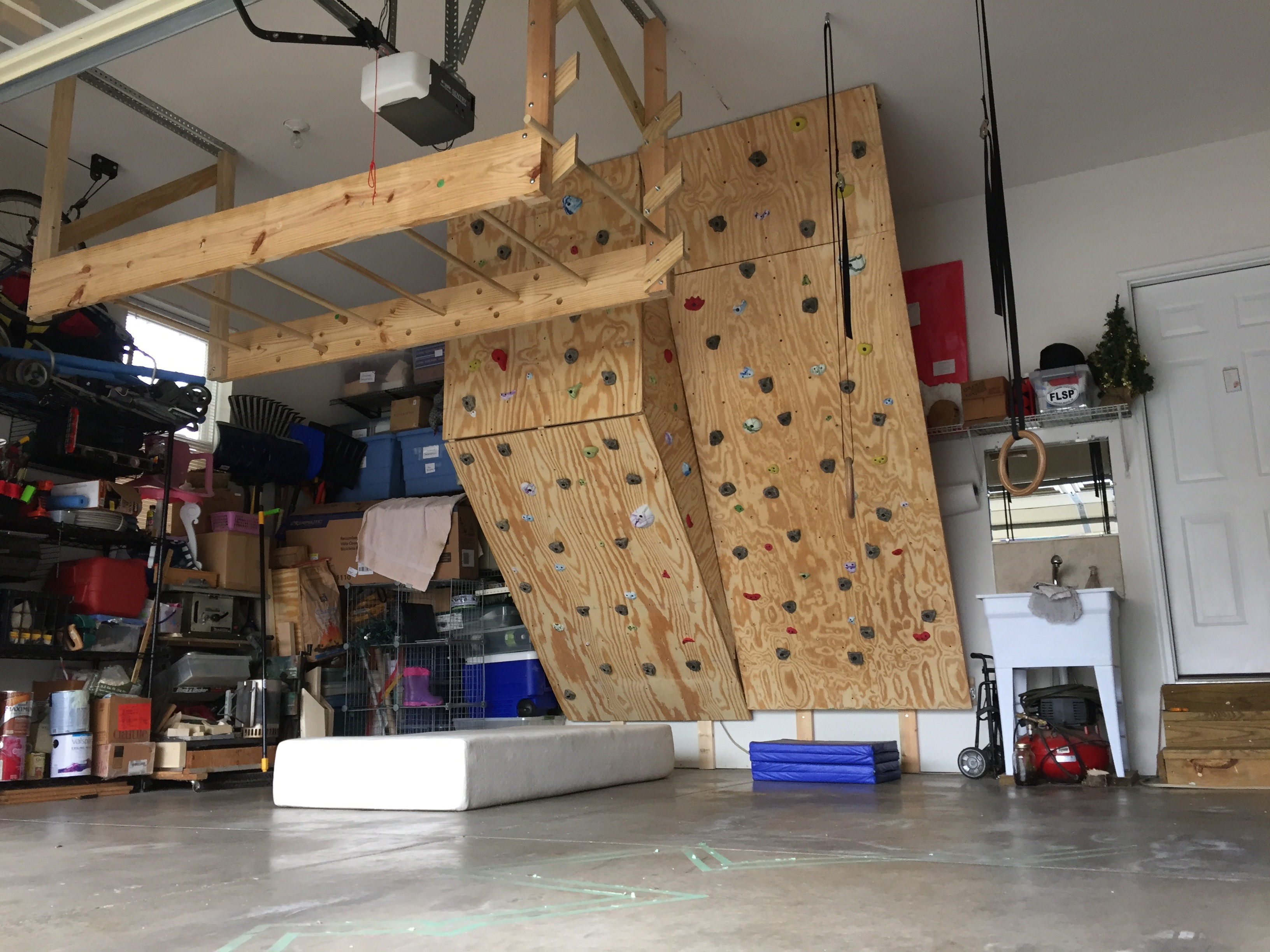 The bouldering wall rounds out the garage